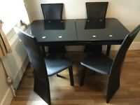 Extendable 6 Seater Glass Dining Table