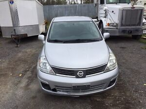2008 versa $3000 or trade for pickup
