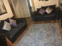2 2 large seated black sofas