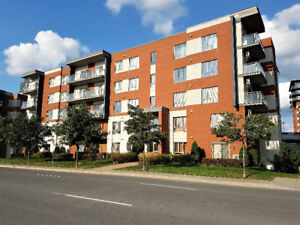 * * * Spacieux Condo - Laval - 2 chambres - Projet Urbania * *