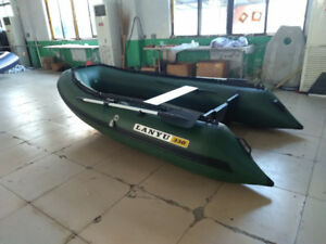 Used inflatable boat 11 ft long (New aluminum floor)