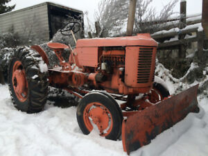 Case Tractor modelVAC with Front Snow Plow and Tire Chains