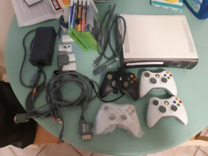 X box 360 + 4controlers + hook ups + games