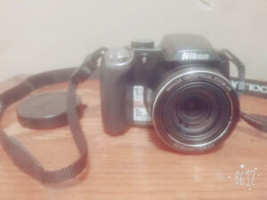 Rikon's Camera ( Nikon Cool Pix P80 with battery charger and a c