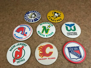 8 LARGE VINTAGE NHL TEAM BUTTONS WHALERS NORDIQUES NORTH STARS