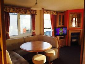 For hire -8 berth Silver+ caravan with secluded patio area holiday park 7 miles golden Sandy beaches
