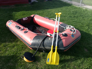 10' zodiac inflatable boat/raft with paddles  for trade/sale
