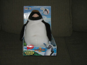 Taking stuffed penquin toy