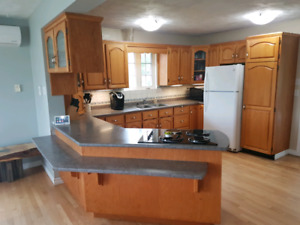 Home with Double heated garage,  income property