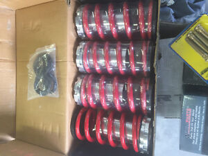 (Brand new set of coil sleeves adjustible coilovers civic mazda