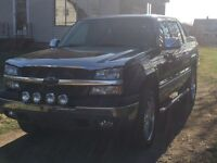 04 Avalanche $6000 chrome rims and tires included for extra