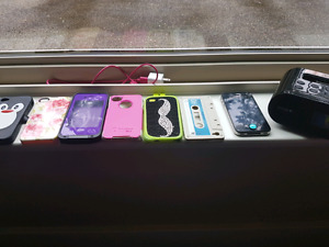 iPhone 4 with 6 cases, docking station and charger cord