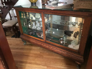 Antique oak display cabinet with storage drawers