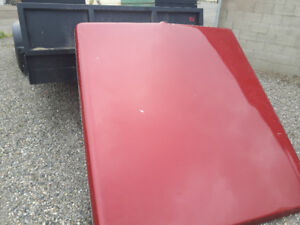 Red fiberglass tonneau cover for 1998 short box Ford