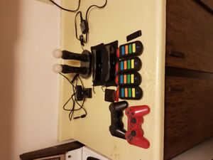 Playstation 3 slim, mint condition. 2 controllers with games