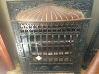 Antique United States steel company electric cast fireplace