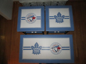 Custom painted Toronto Maple Leafs and Blue Jays tables