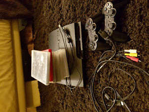 Playstation 3 Slim with 20 games, 2 controllers