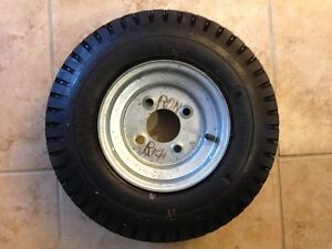 "Wheel With 4.80x8"" Goodyear Tire Four Bolt Pattern"