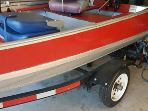 12 ft Aluminum boat with a 9.9 Merc 2 Stroke