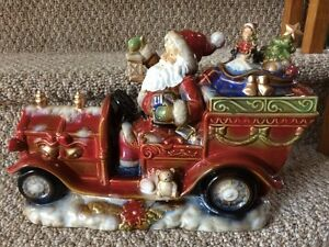 REDUCED Ceramic Santa in a fire truck