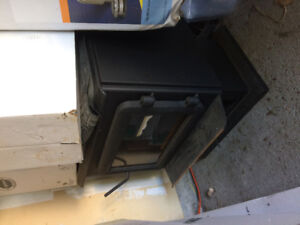 Never used wood stove for sale with all the accessories