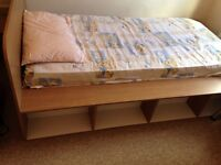 Single bed with mattress .