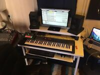 Roland synth keyboard and m audio speakers