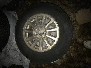 4 215/70R15 tires as New on ford 5 bolt rims
