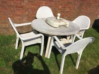 Patio table and 4 chairs. Good quality