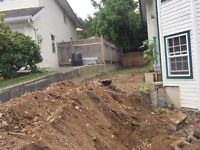 Bobcat Service  levelling, retaining wall, cleanup