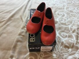 Red tap shoes, used.