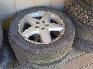 2 aluminum rims and tires from a 98 z24 cavalier