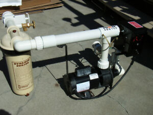 Hot tub pump with heating and filtration system