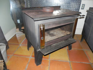 Drolet wood stove with glass front
