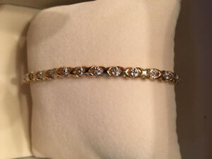 10K Gold 'Hugs and Kisses' Tennis Bracelet with 15 Diamonds