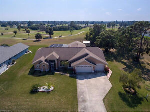 **LARGE POOL HOME ON GOLF COURSE** - LOCATED IN LEHIGH, FL