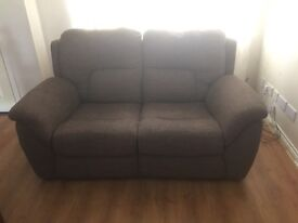 Brown cloth double recliner sofa