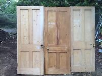 Three old pine doors