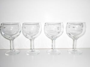 4 CLEAR WINE GLASSES WITH A DELICATE WHITE SWIRL PATTERN ON BOWL