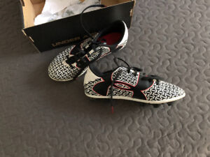 Under Armour soccer cleats, youth size 1