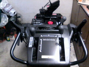 Craftsman 1450 Series snowblower - like new.