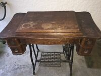 Antique Treadle Sewing Machine in cabinet, bobbins, accessories