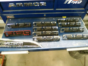 F150 and a F250 fender nameplates