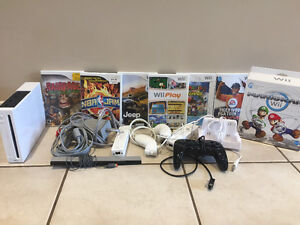Wii console with three controllers games and accessories