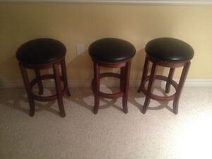 Three bar stool spinning chairs