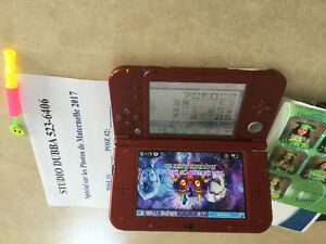 New 3ds xl mint condition with charger and 29 games 32gb sd card