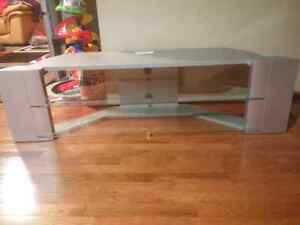 """Silver tv stand like new can hold tv over 50"""" for $30."""