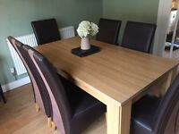 Solid dining room table and 6 leather and suede chairs