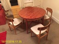 Dinning table & 4 matching chairs. Delivery might be available upon request.